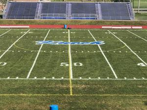 field with Knoch logo