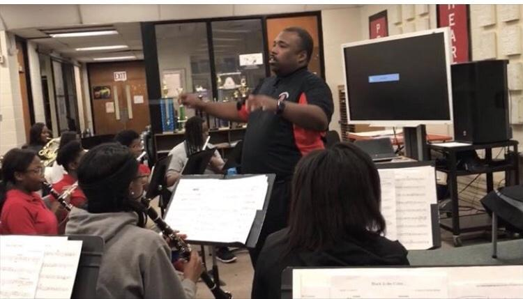 Photo of William Earvin directing the Baker High Symphonic Band