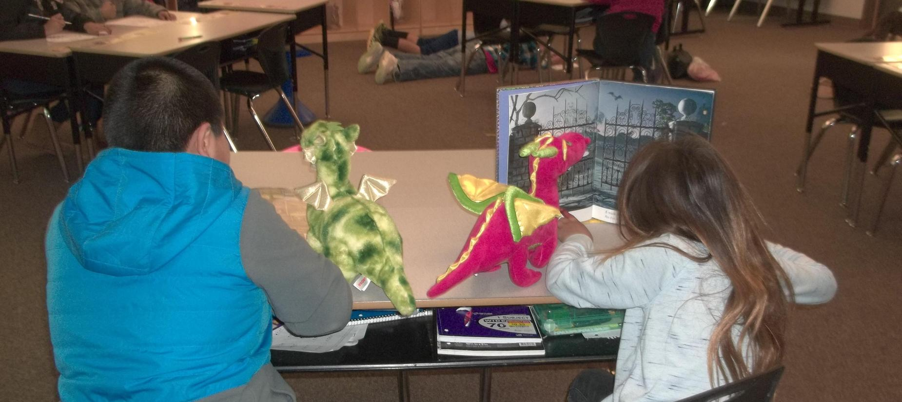 Students reading books with stuffed animals