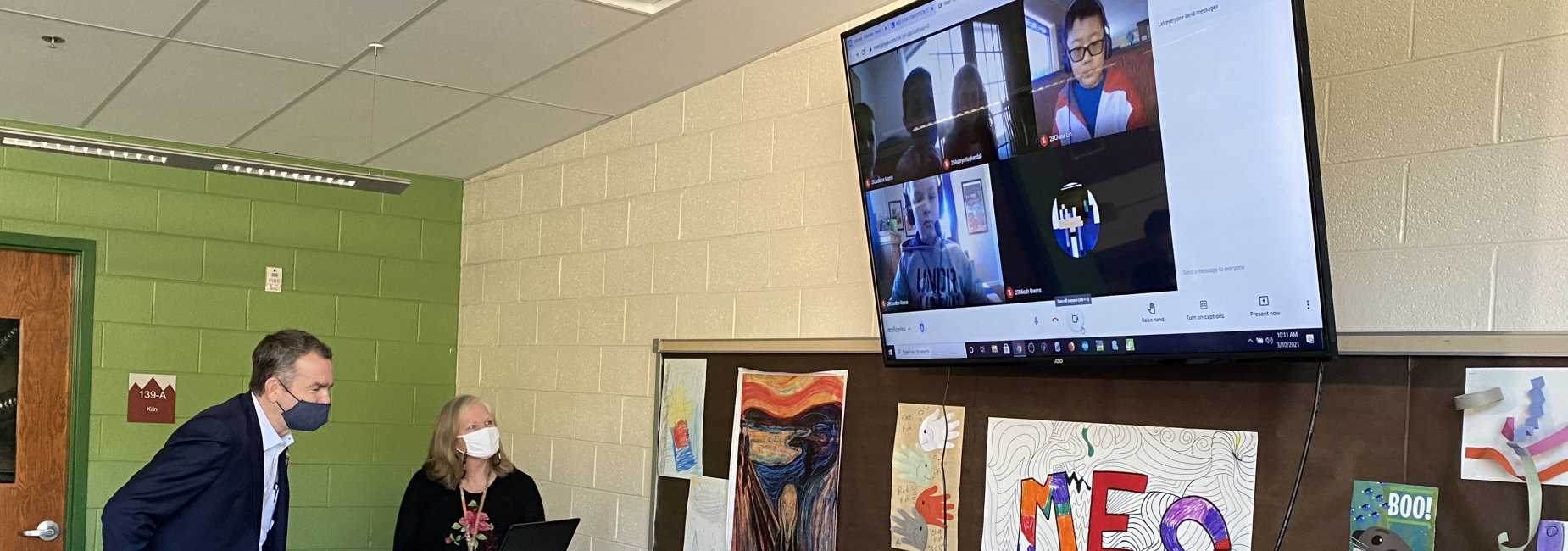 Virginia Governor Ralph Northam visits virtually with students in Marion Elementary School's STEM Competition Team, as team sponsor/MES school counselor Kay Richardson looks on.