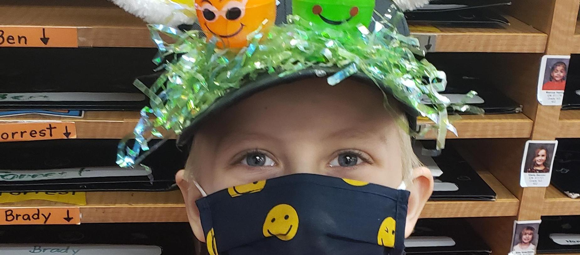 boy wearing an Easter hat
