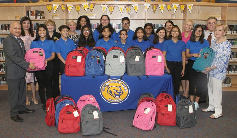 Longoria Middle School National Junior Honor Society members, Edinburg CISD administrators and Edinburg Rotarians are pictured with backpacks filled with school supplies that will be distributed to students at the campus.