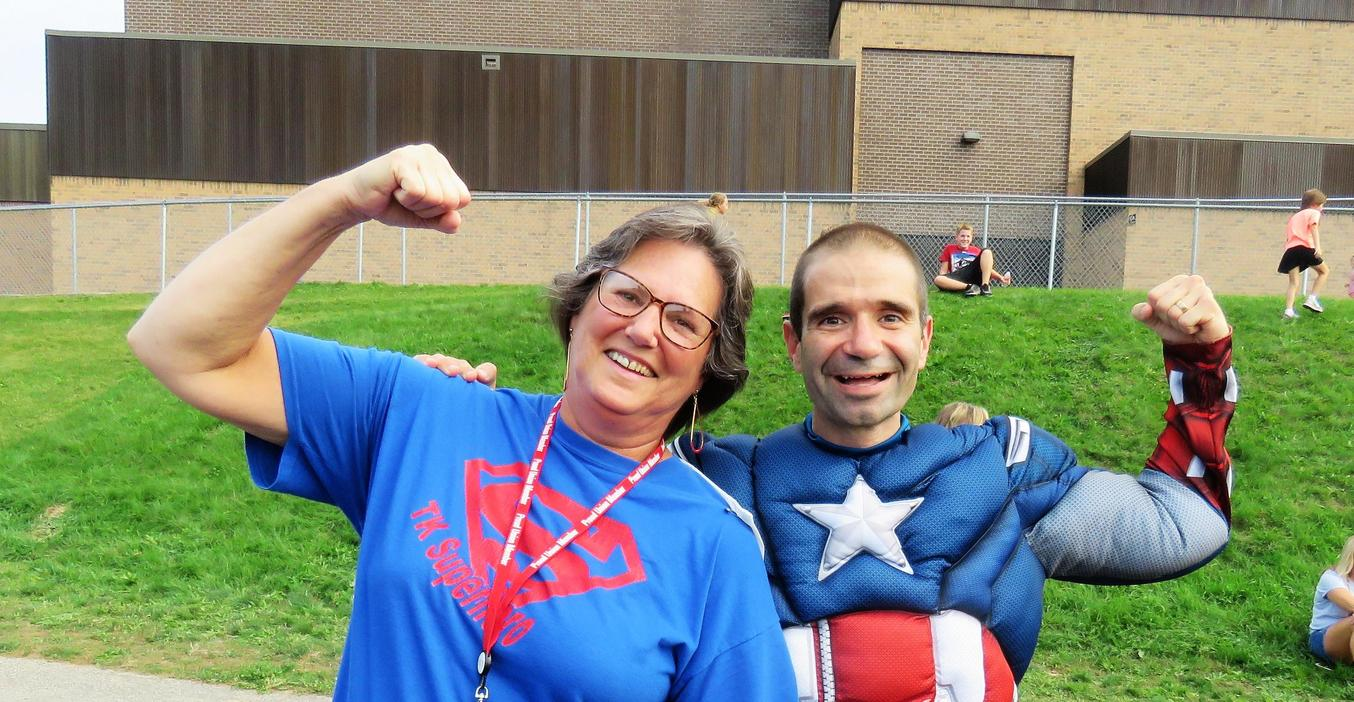 Page principal Gregg Bruno and Librarian Diane Knight flex their Super Hero muscles at the annual walk-a-thon.