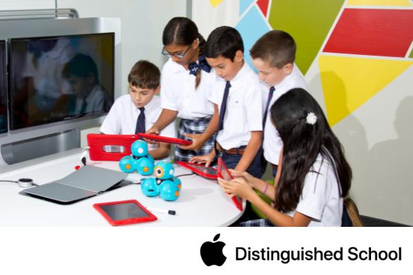Intermediate student programming Dash & Dot using their iPad.