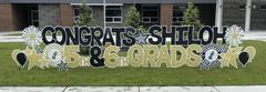 Colorful yard display congratulating 5th and 6th grade graduates.