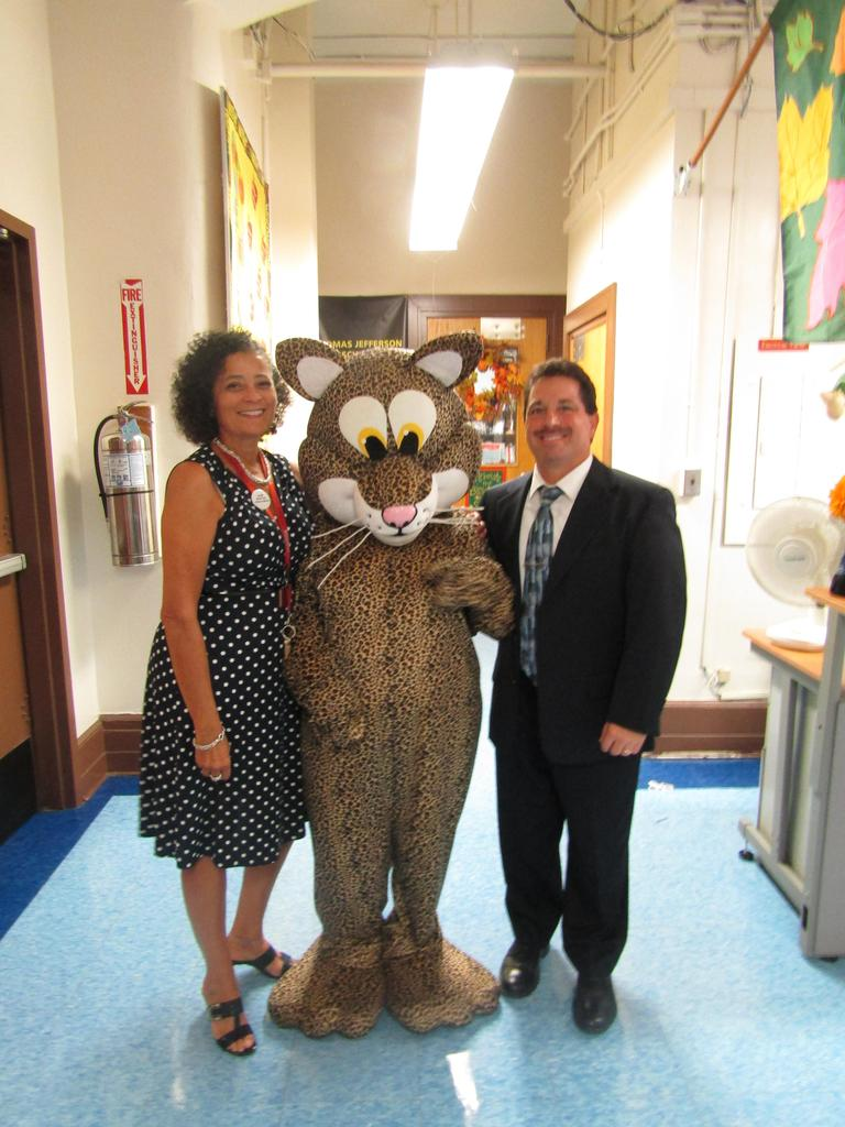 principal mr. celebrano and supervisor mrs. tortorella with school mascot in main hallway