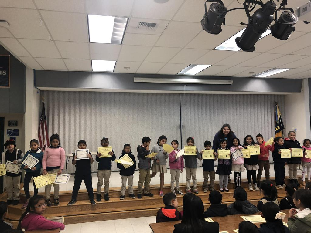 trimester one award winners in Ms. Hernandez's class pose for picture