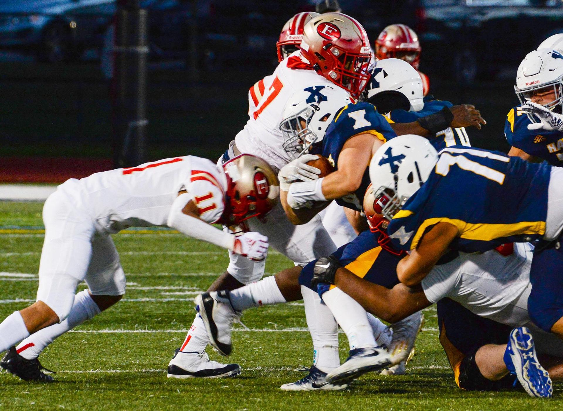 A EHS defender lowers his head and makes a tackle