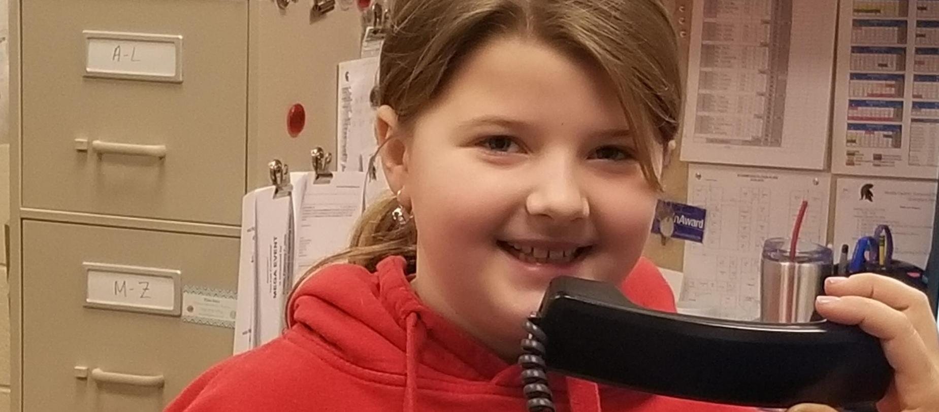 Student doing morning announcements