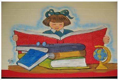 Picture of a female student reading a book, painted on the wall.