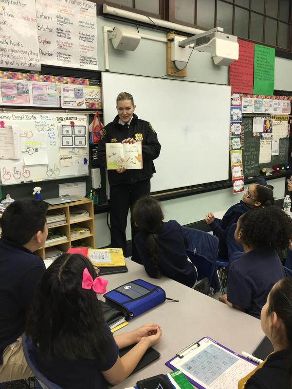 UC Chief of Police luster reading to students at Edison School