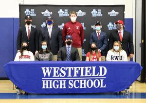 Photo of WHS seniors who signed letters of intent to play sports at the college level.