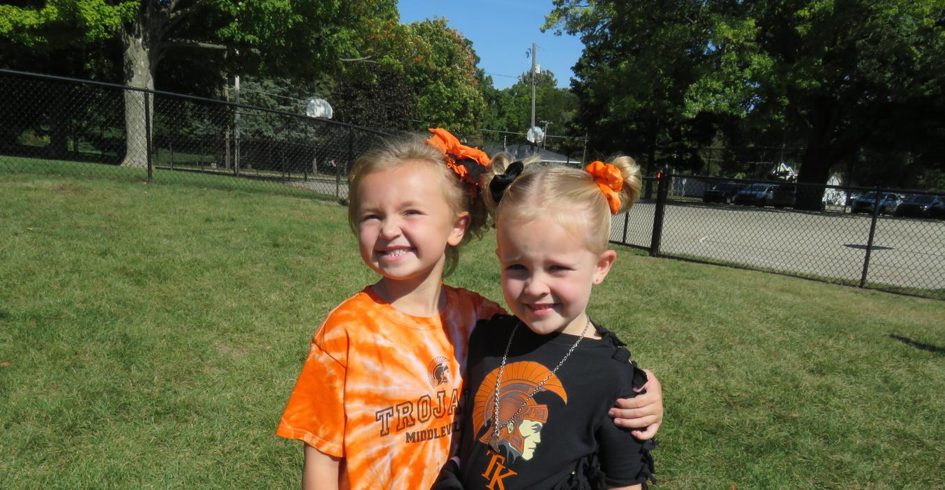 Two McFall girls proudly wear their orange and black for spirit day.