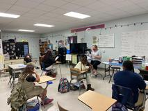 Jumpstart:  Read for Record - Mrs. Johnston reading book to class