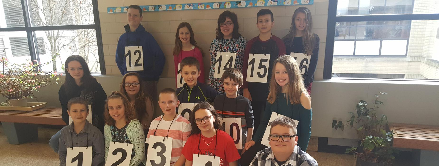 A picture of sixteen Elementary students that participated in the Spelling Bee.