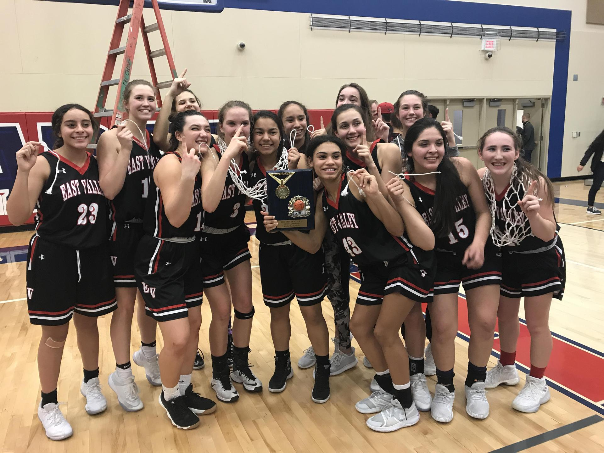 Varsity Girls Basketball wins District Title