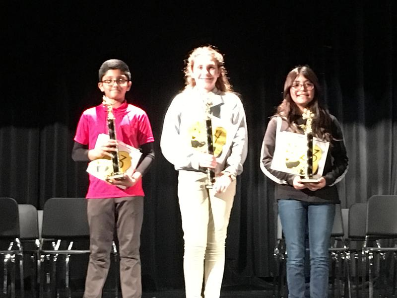 Top three District Spelling Bee contestants