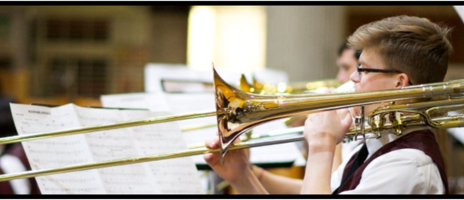 students playing the trombone