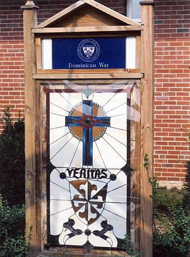 Veritas stained glass designed and crafted by alumni parent, Donald L. Hollandsworth, D.O. Dedicated 2002, and mounted in the Dominican Way Courtyard.