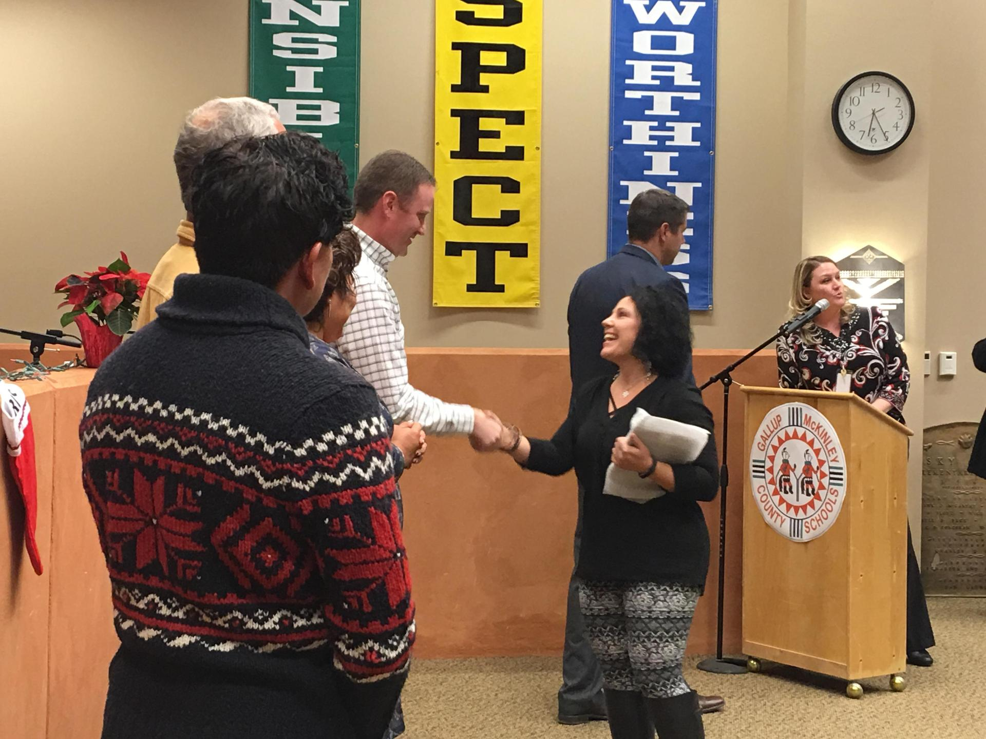 Teacher shaking hands with Board Member