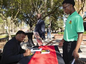 Cameron Jackson, Grade 9, receives an autograph