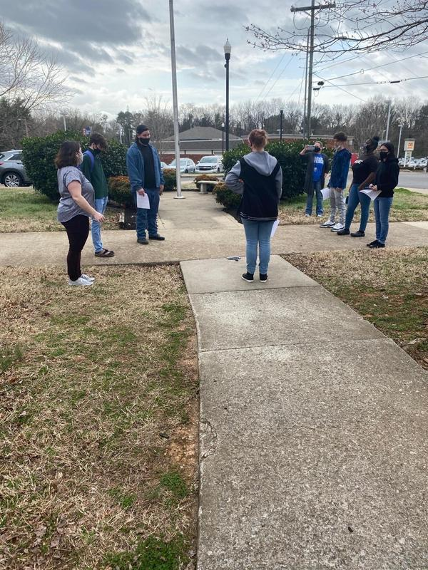 Monica White and students measure a flagpole using a mirror