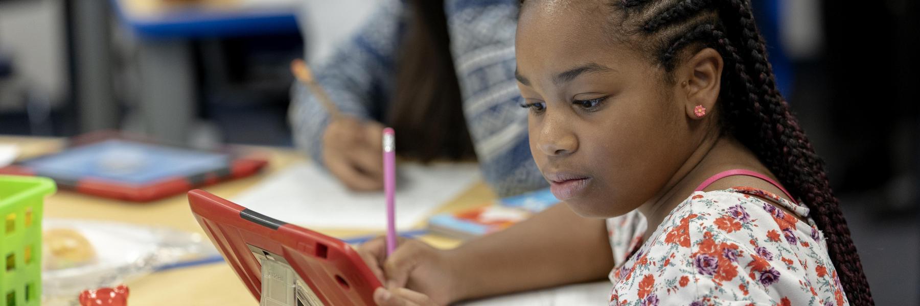 Student on iPad