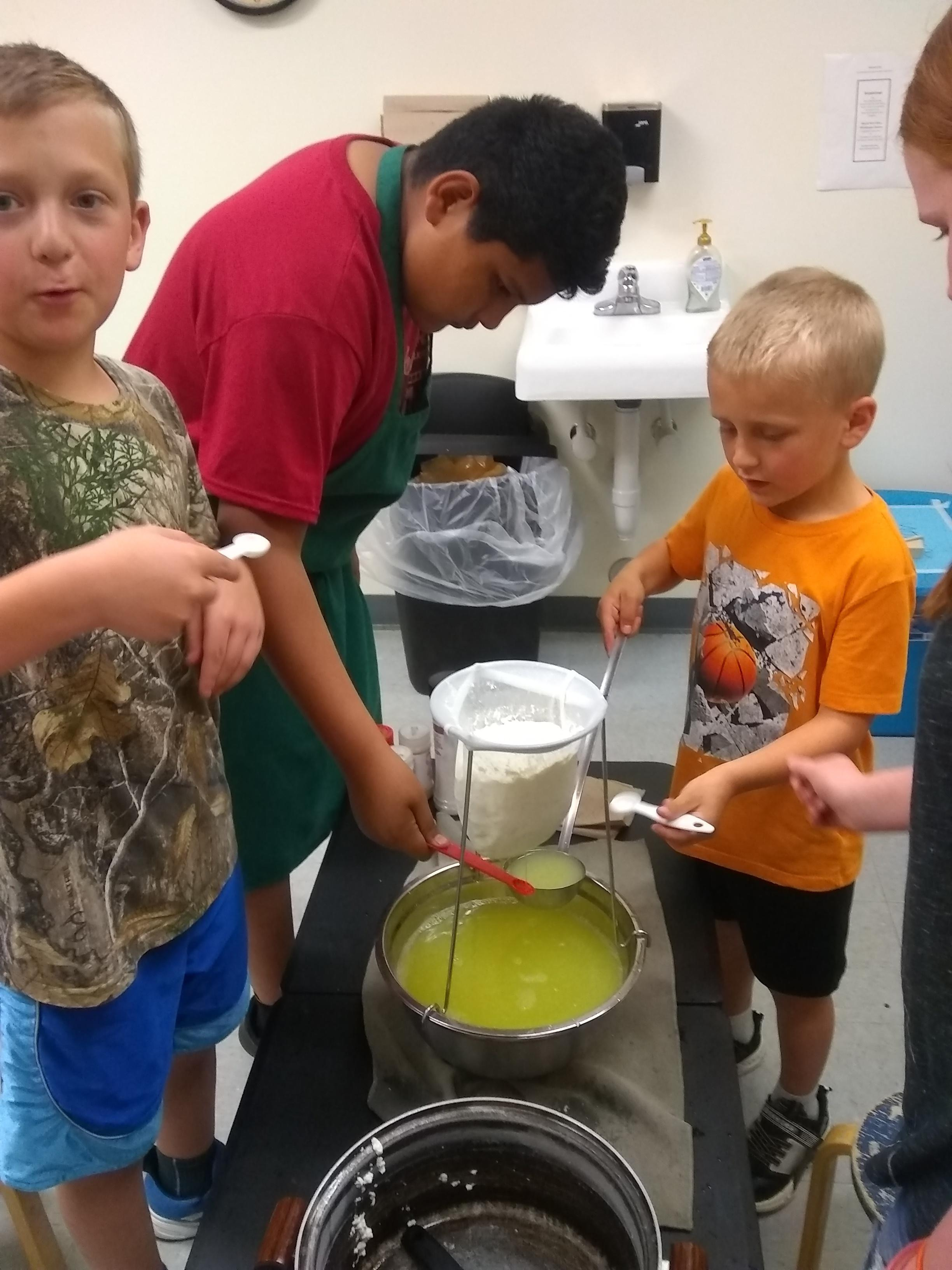 students sampling the whey
