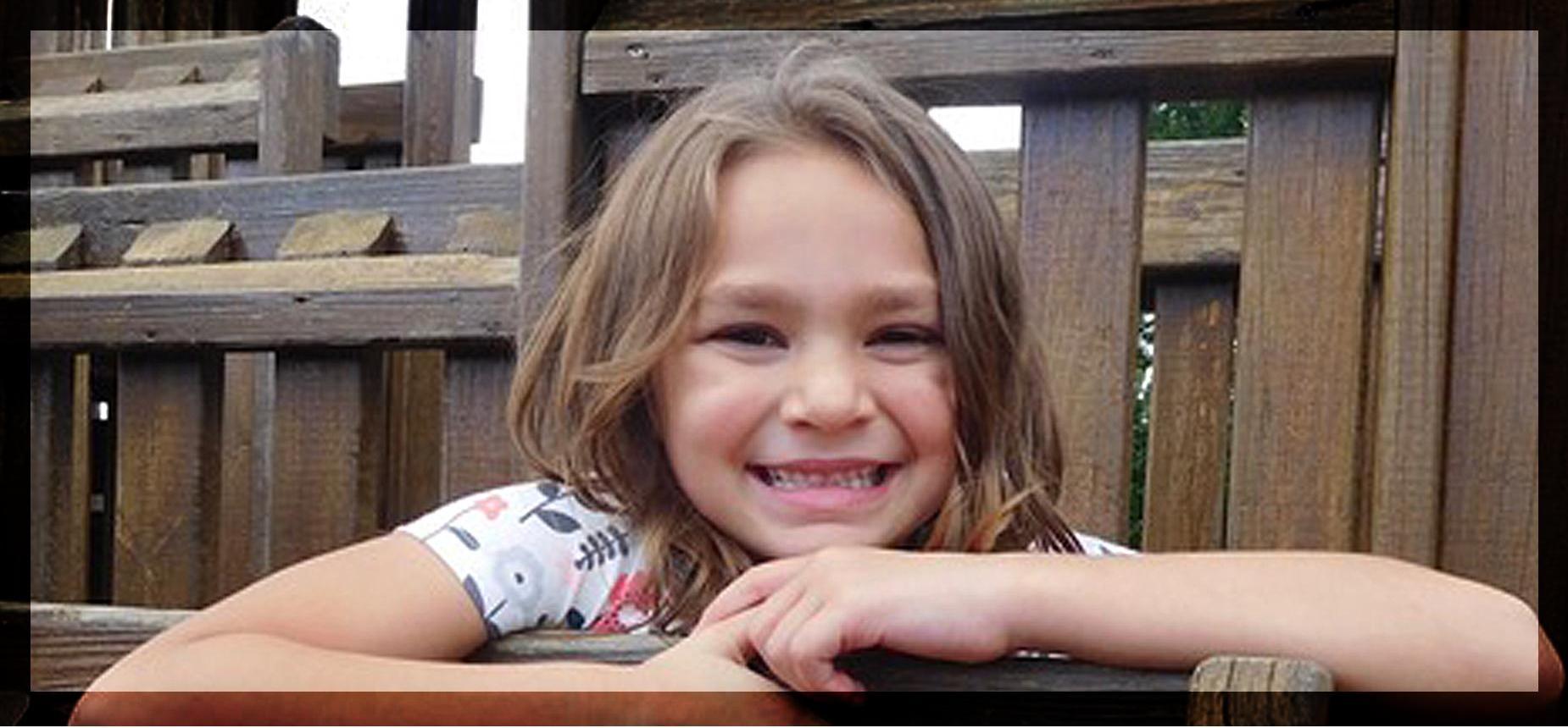 Elementary student on playground smiling