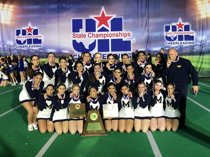 cheer team posing with gold medals