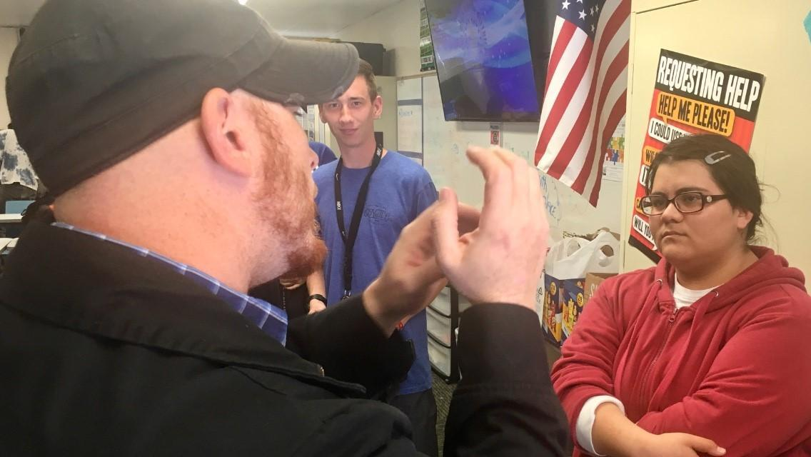 Local director speaks with students