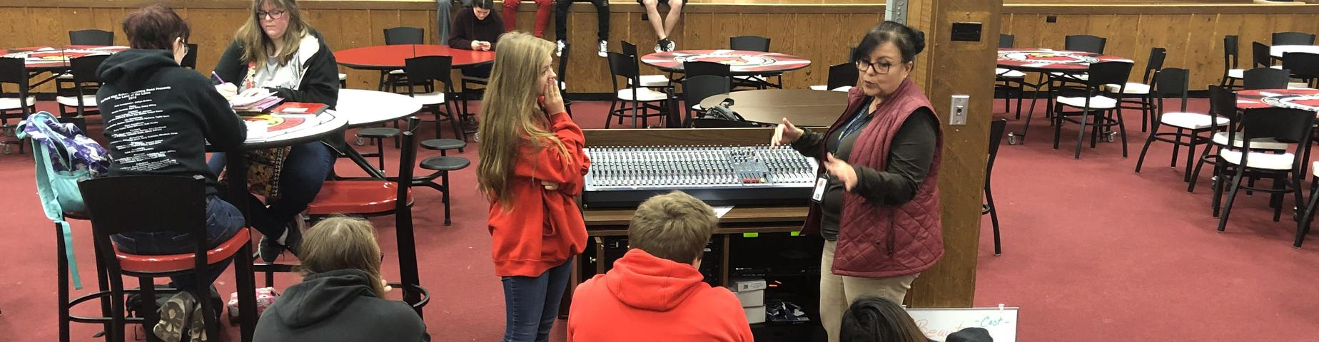 Mayfield High School teacher, Mrs. Martin is showing her Media Class how to work the sound board.