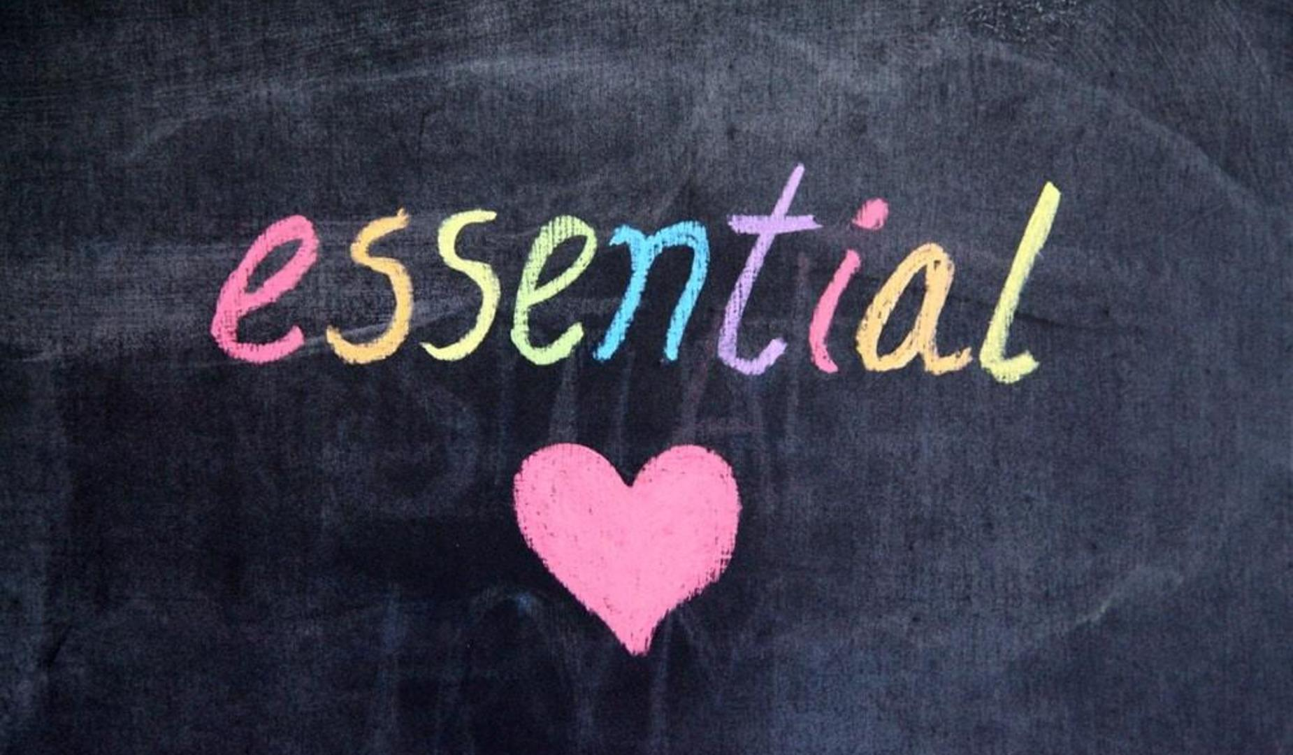 Essential spelled out with heart on chalkboard
