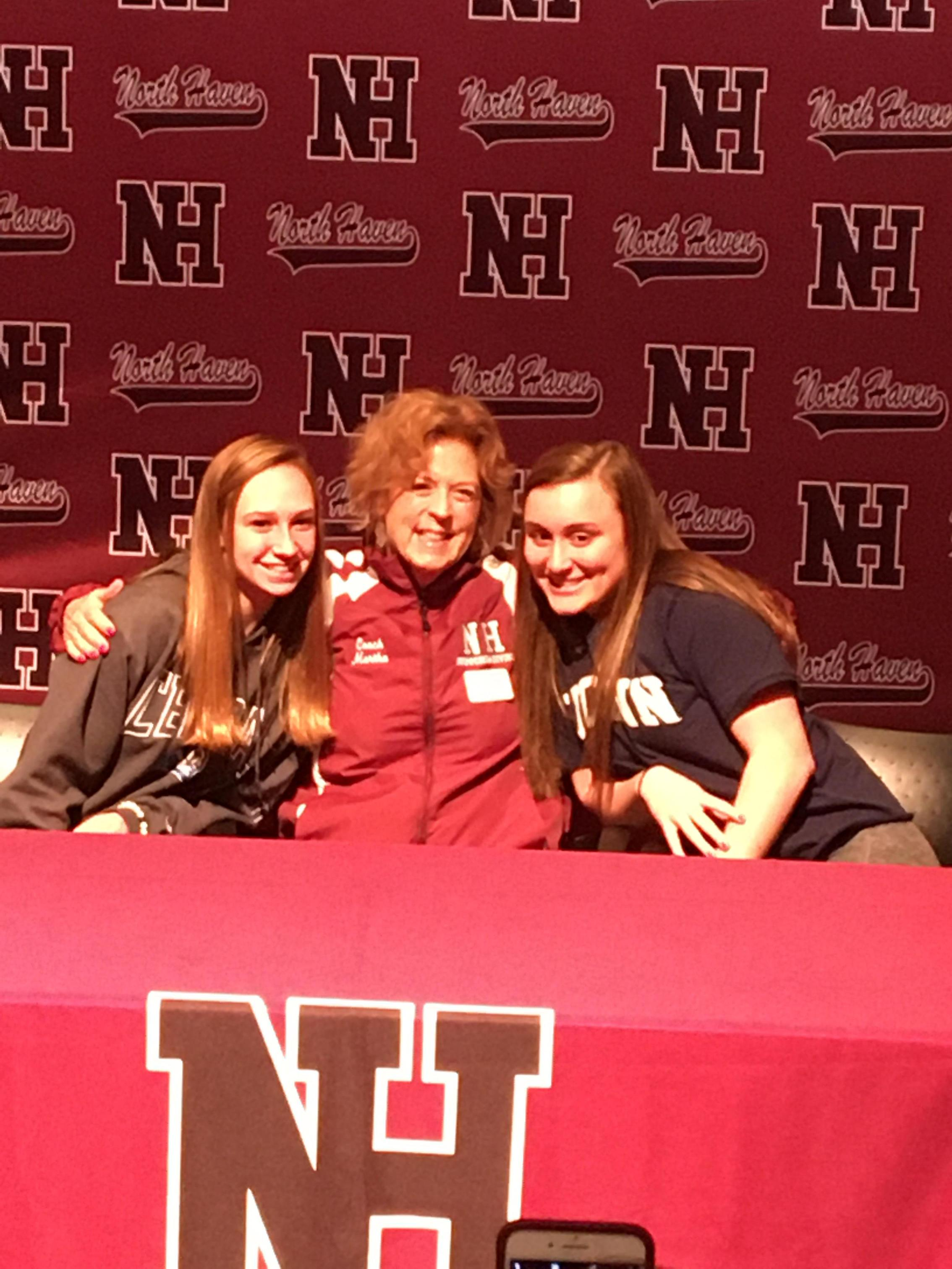 Coach Martha Phelan and her student-athletes after they signed their NLI.
