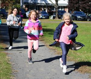 Students run laps as part of the Recess Runners Club at Washington Elementary School.