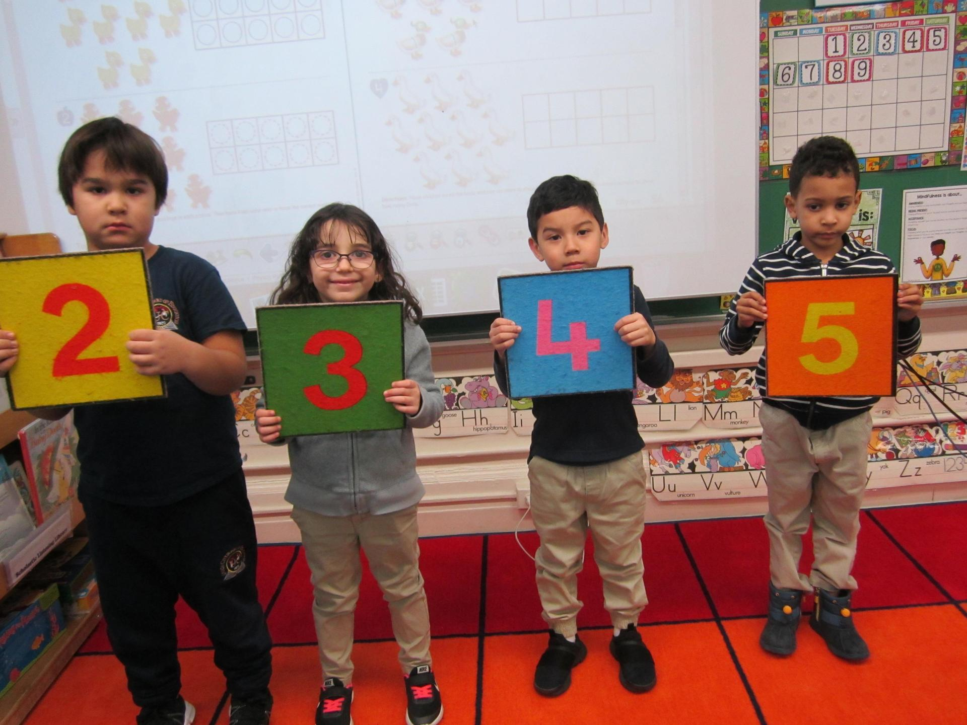 boys and girls holding numbers 1-5