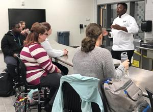 Culinary Arts instructor Isaac Pressley talks with students in the state-of-the-art commercial kitchen at the center.
