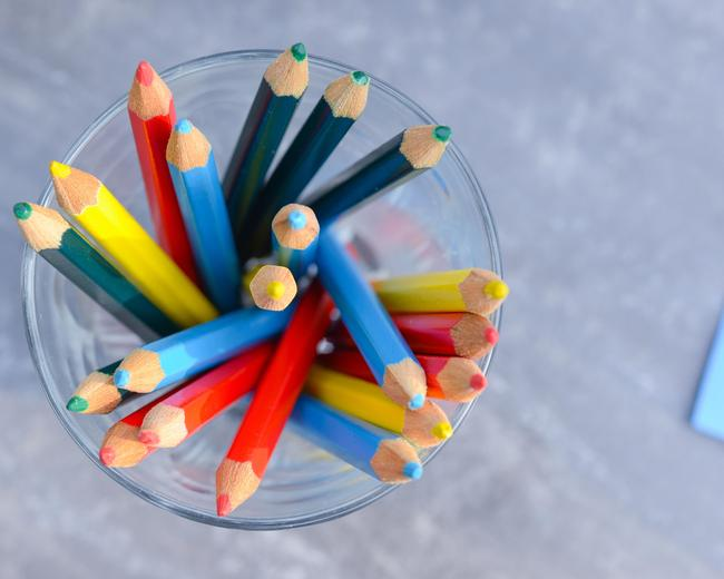 colored pencils in a cup