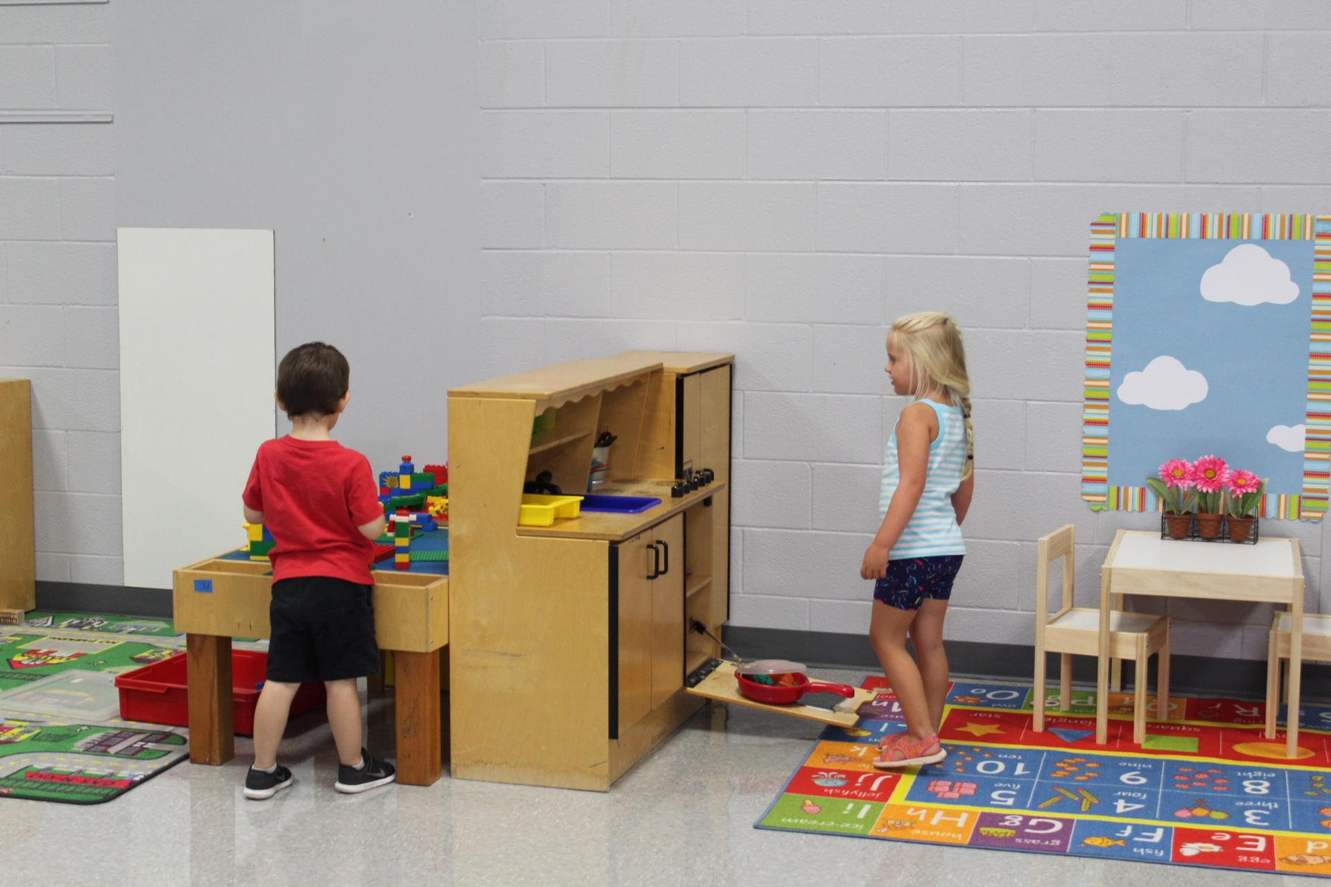 Students exploring their classroom at meet the teacher
