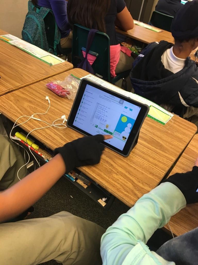 Student touching iPad screen