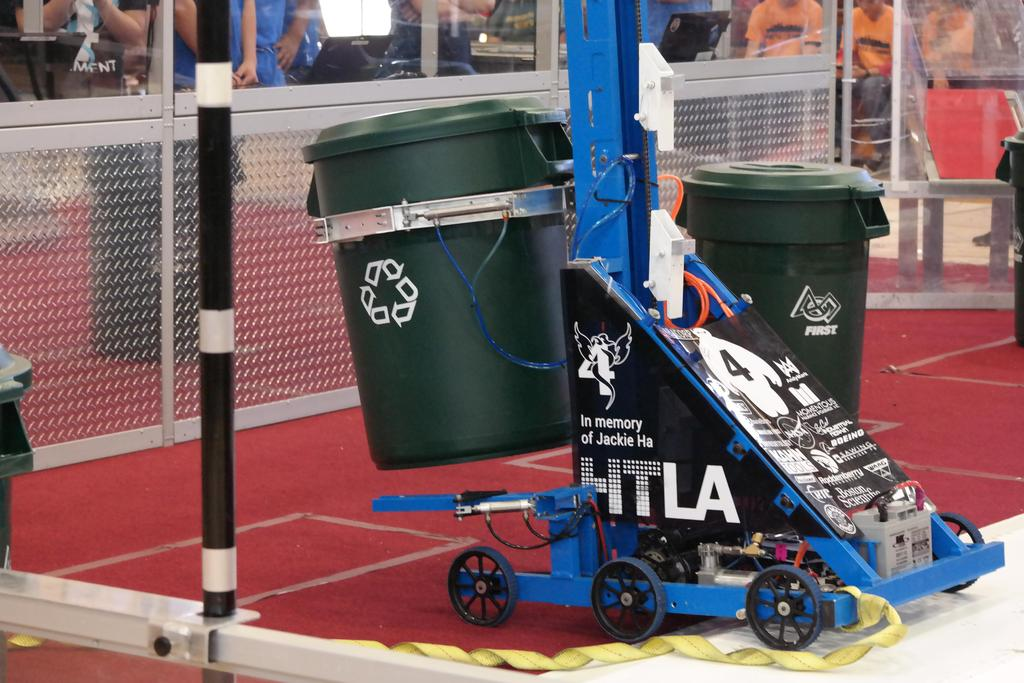 Robot holding recycling container