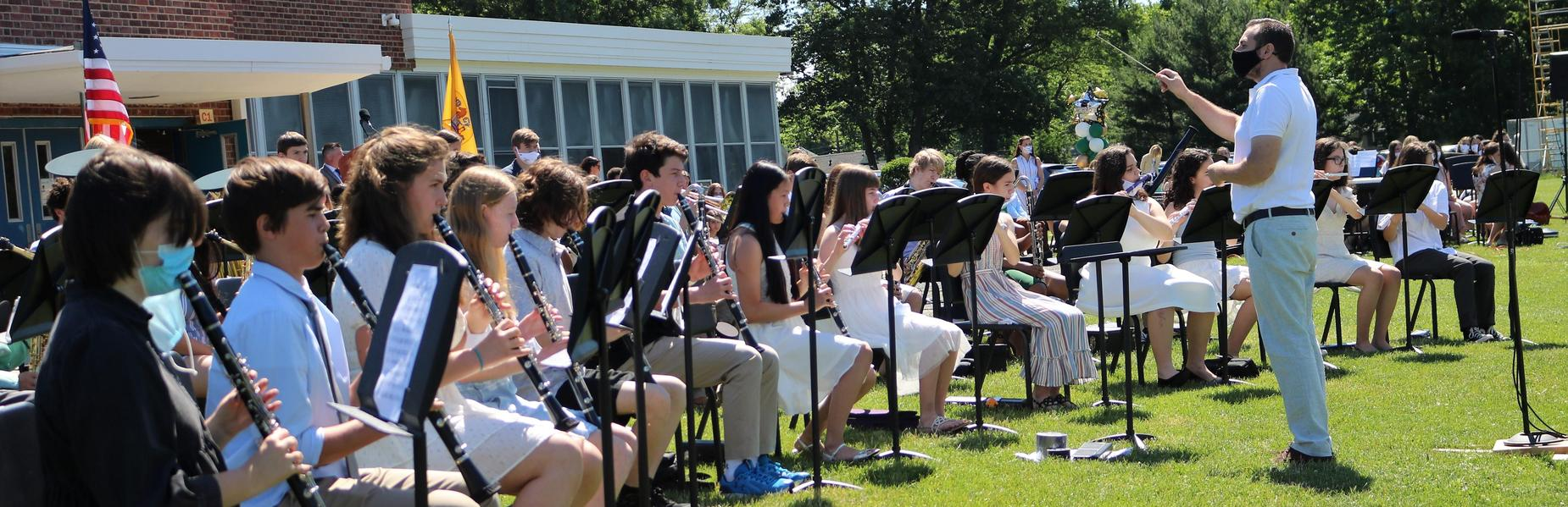 Photo of Edison 8th grade band performing during promotion ceremony.