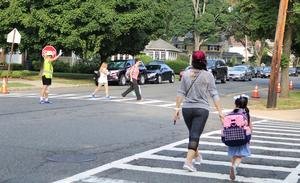 Franklin School crossing guards helps families cross the street during first week of school.