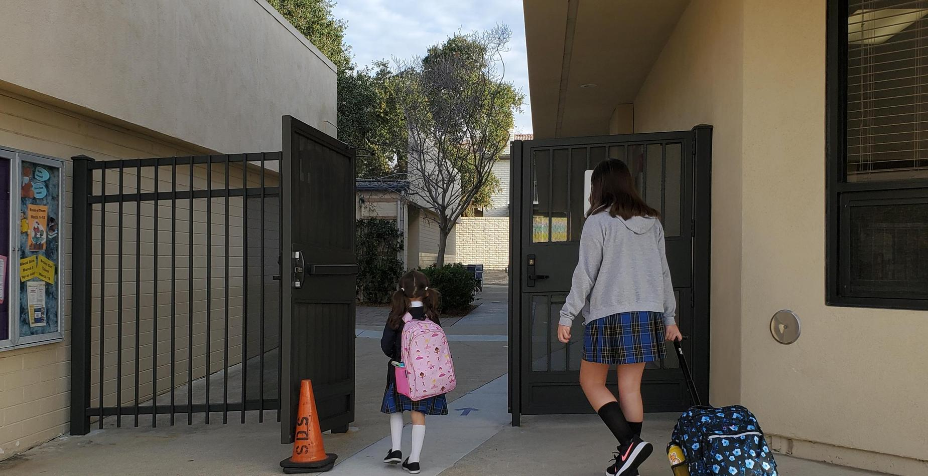 Our Bruins entering our school grounds