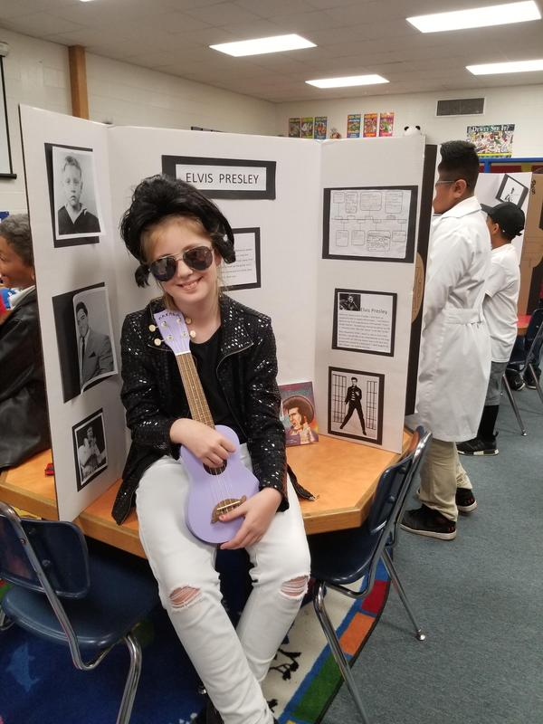 girl dressed as Elvis Presley