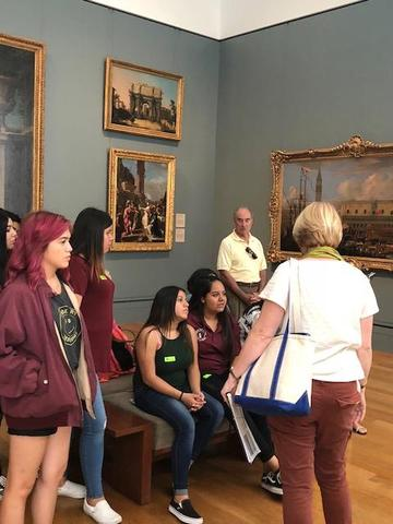 Students admiring Getty art exhibit