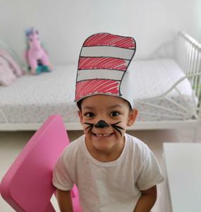 Mila wearing cat in the hat hat and whiskers