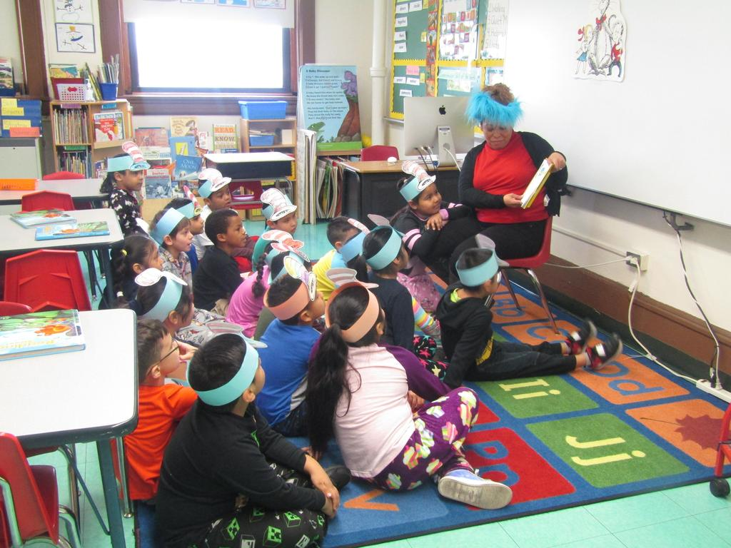 first grade class being read a dr. seuss book