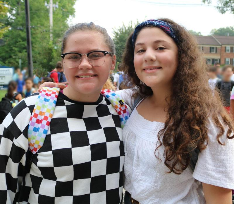 Two RIS students smile as the return to school for new year.