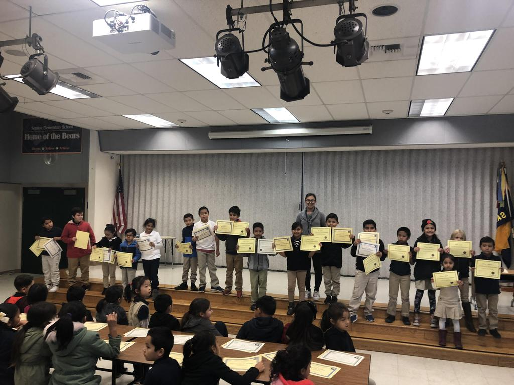 trimester one award winners in Ms. Hong's class pose for picture